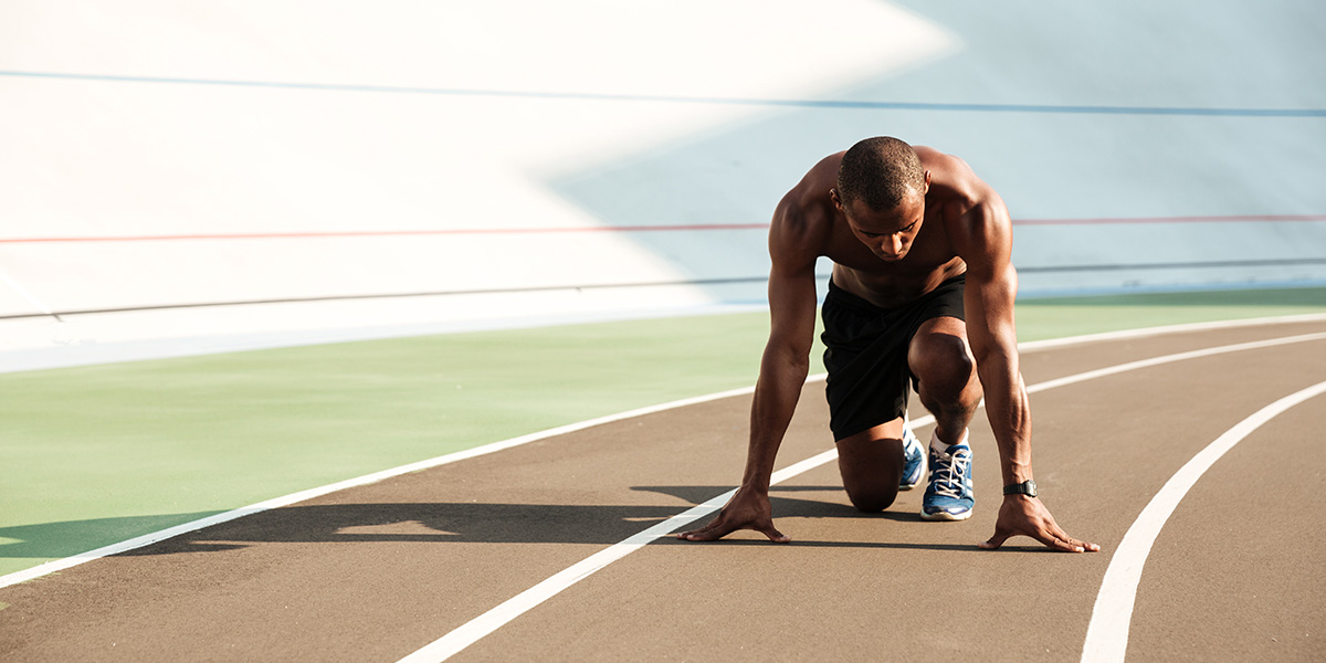 Afro-American athlete on a running track.