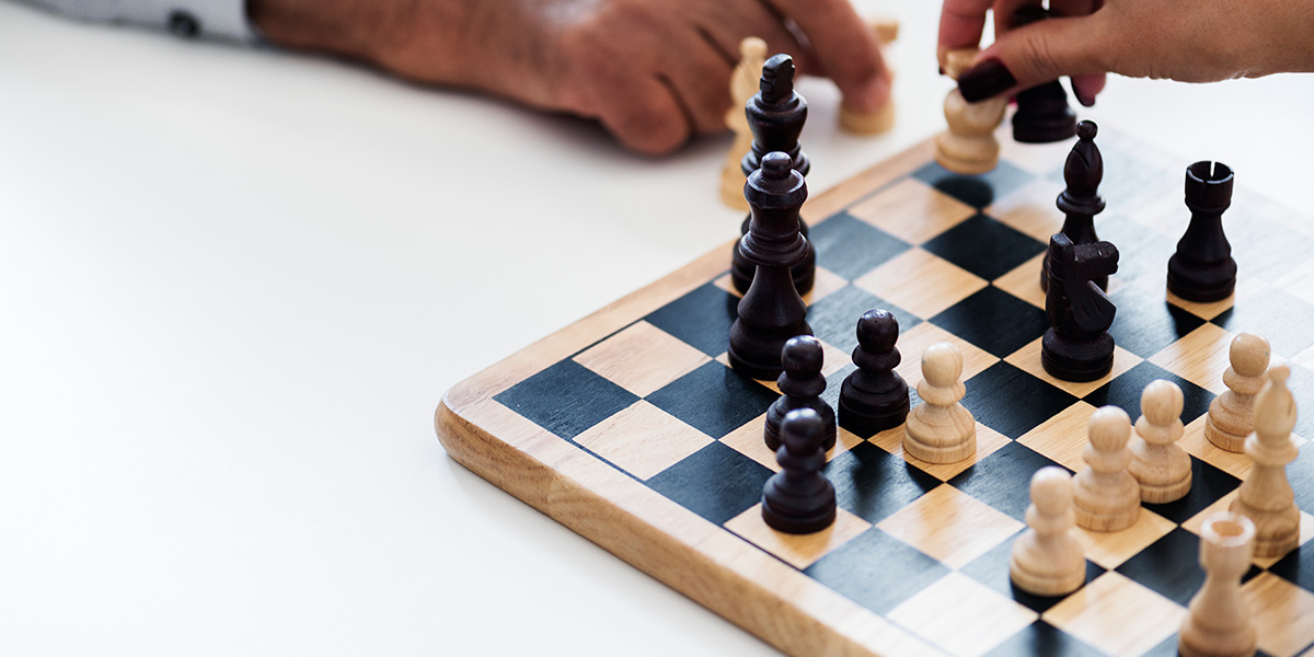 Two people playing a game of chess.
