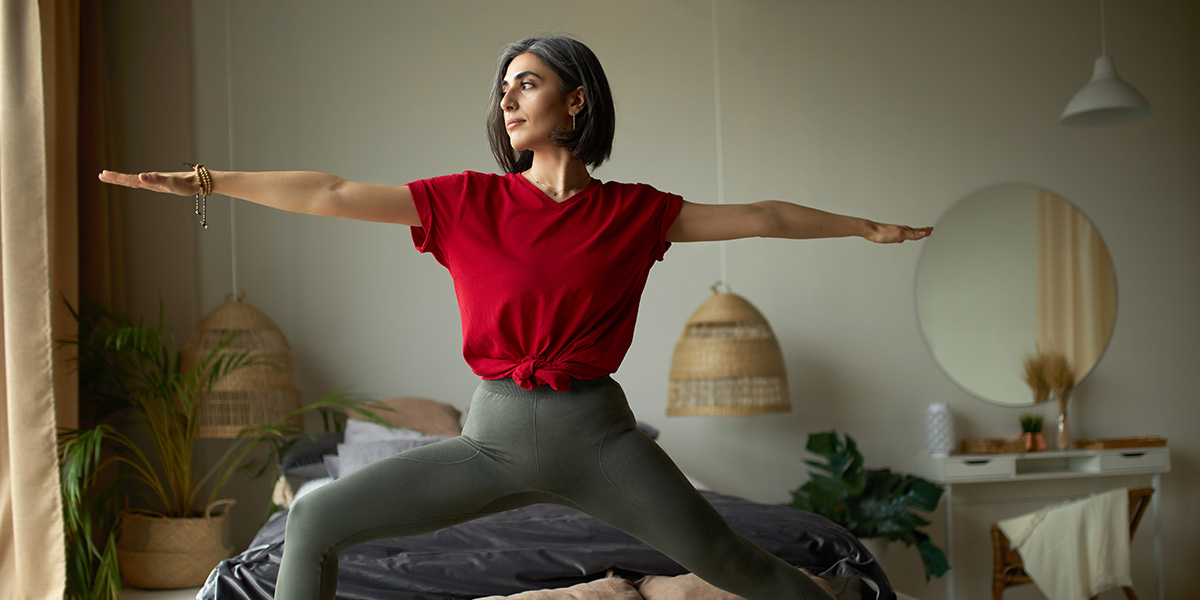 A woman with a healthy posture doing yoga.