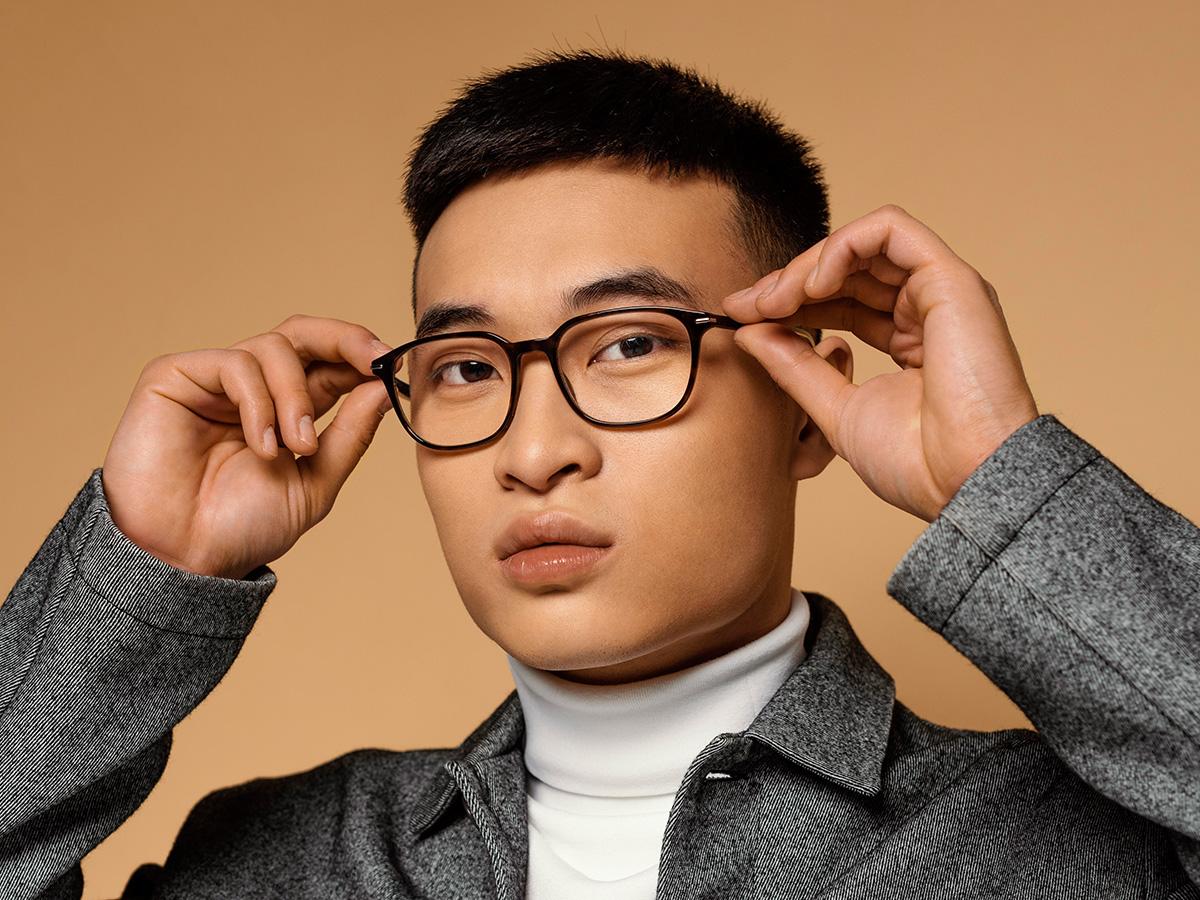 Confident body language - a confident Asian man.