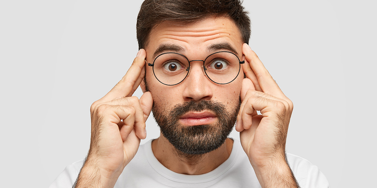Get out of your head - a guy with glasses pointing to his head.