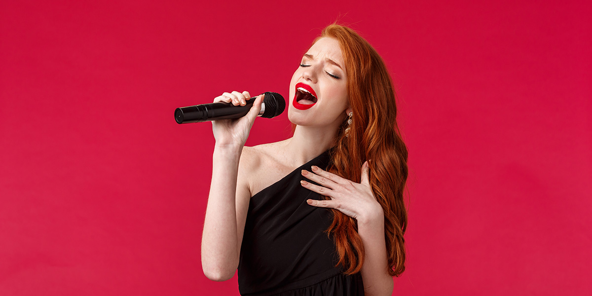 Young woman singing.