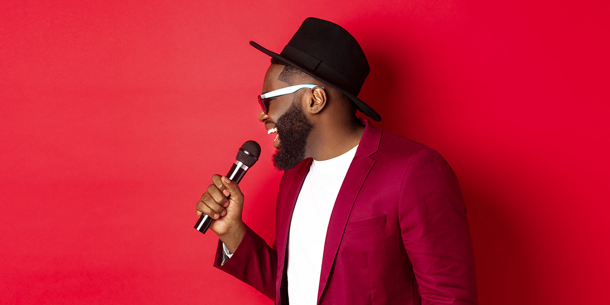 Young man singing.