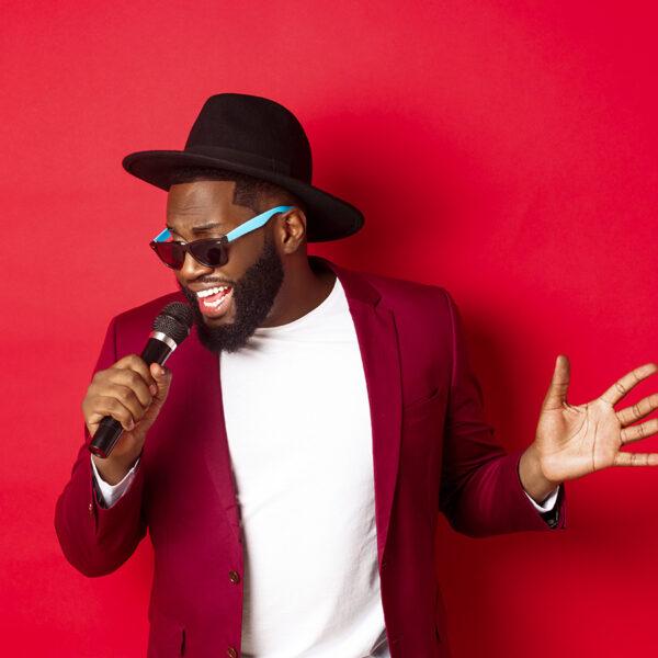 Best karaoke games - young man singing.
