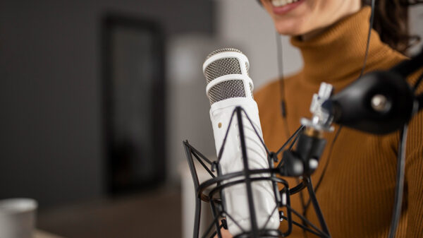 Best storytelling podcasts list - a young woman behind a mic.
