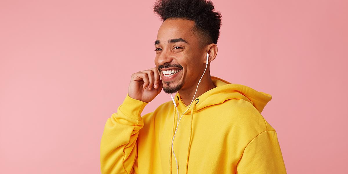 Man in yellow smiling