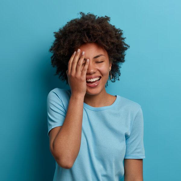 Woman smiling at anti joke