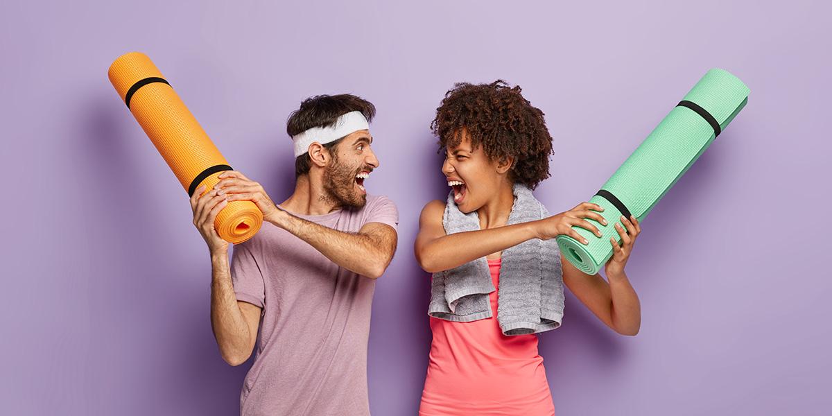 Couple having fun doing fitness.