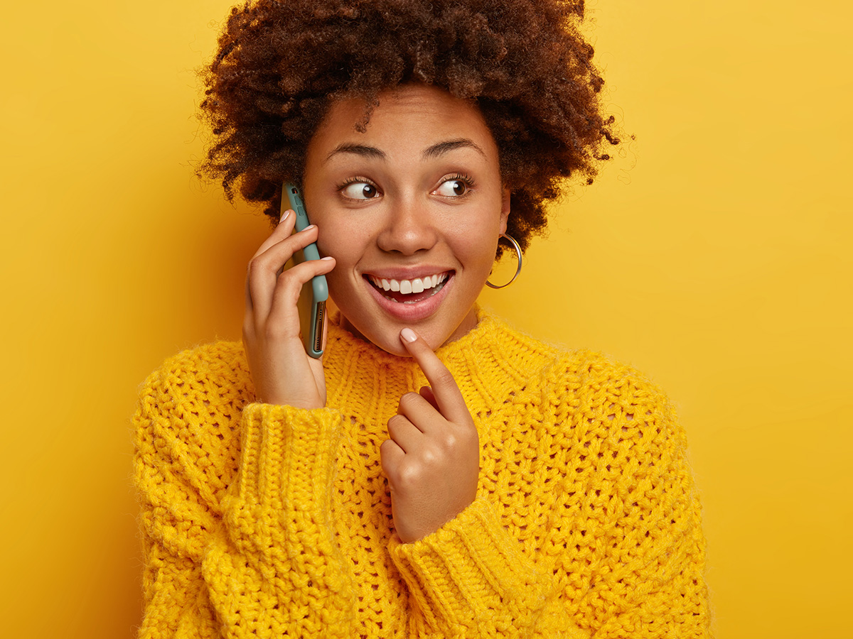 Young woman talking on the phone - 'get in touch' page.