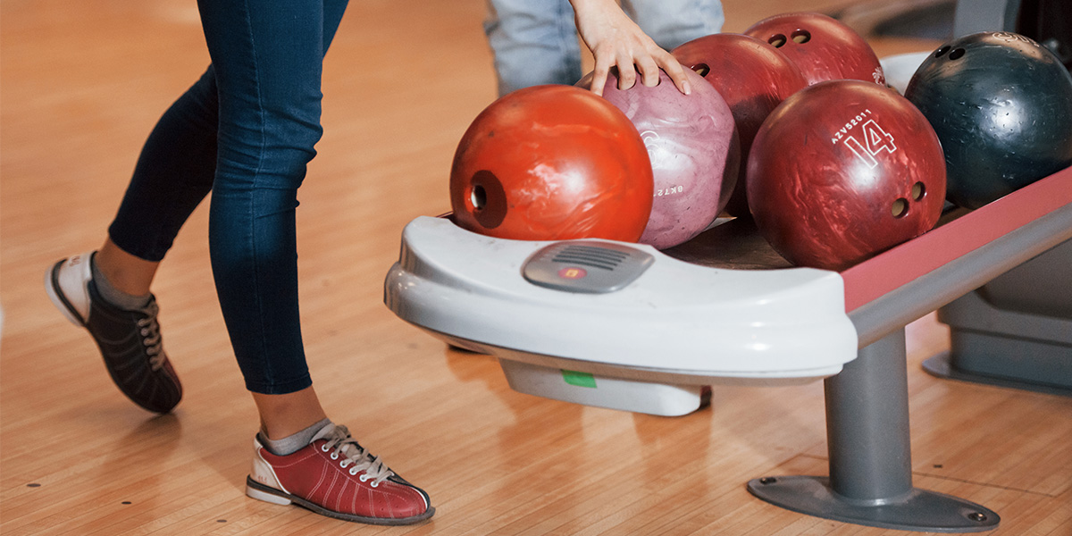 Choosing the right size of the bowling ball.