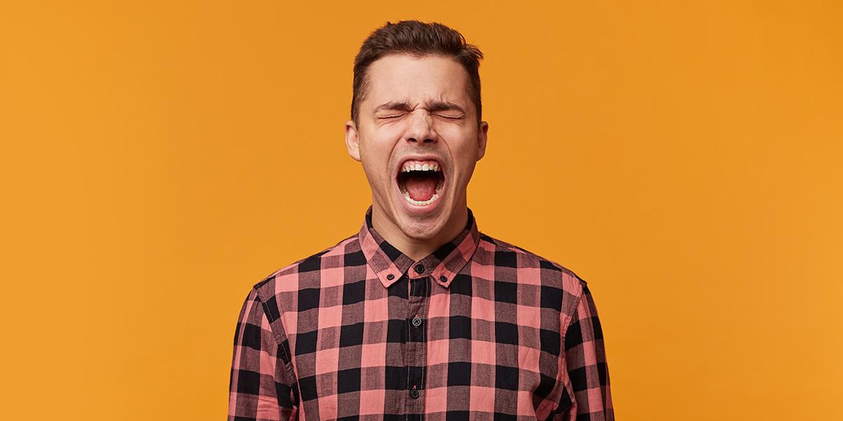 A man yelling.