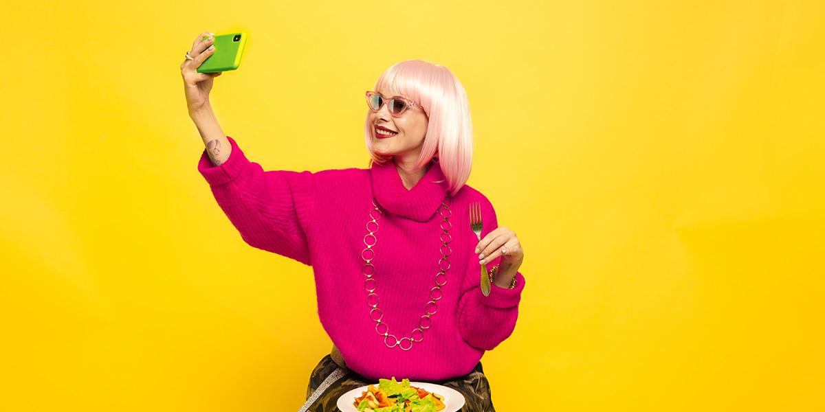 Woman taking social media photo