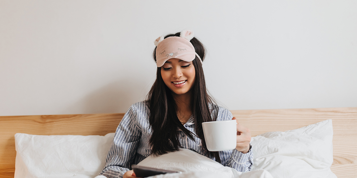 Young girl relaxing in bed