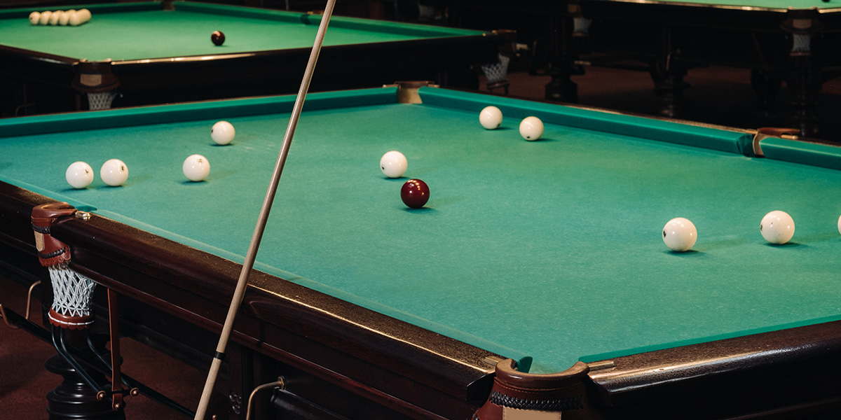 Billiards table or pool table.