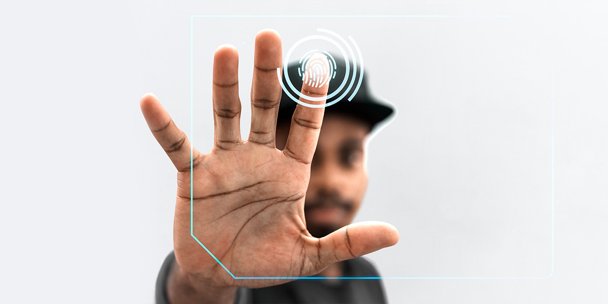 Authenticity - man scanning a finger print.