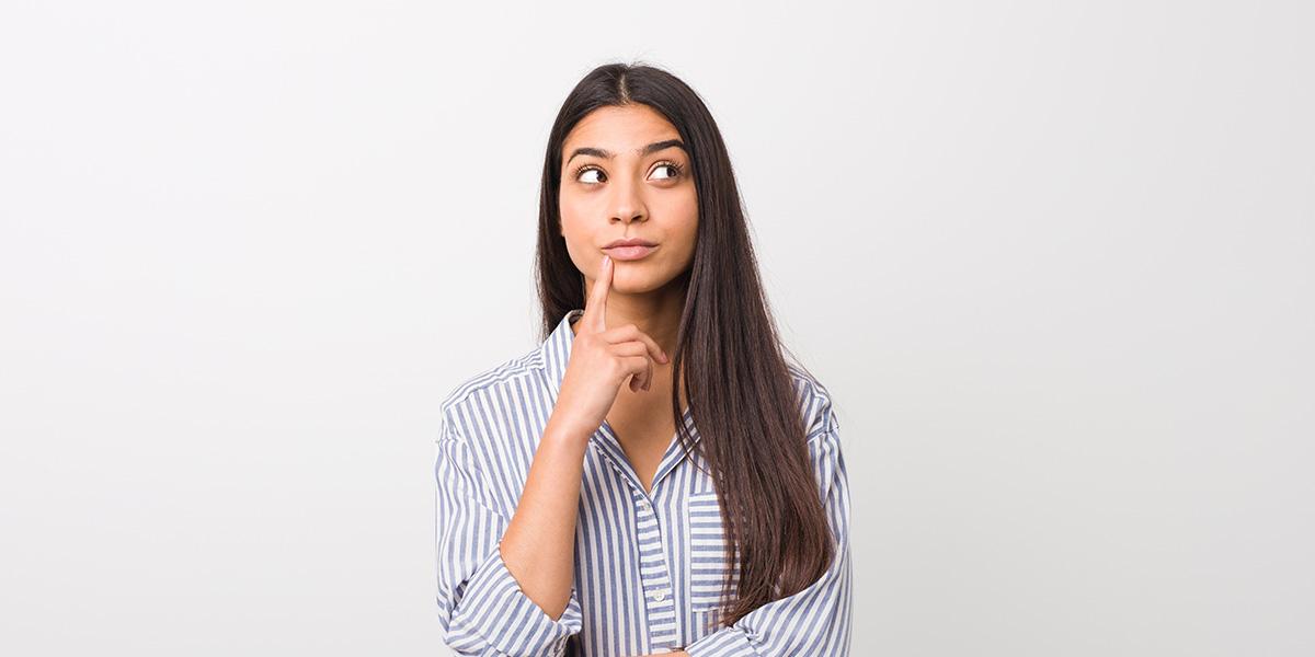 Woman wondering about something.