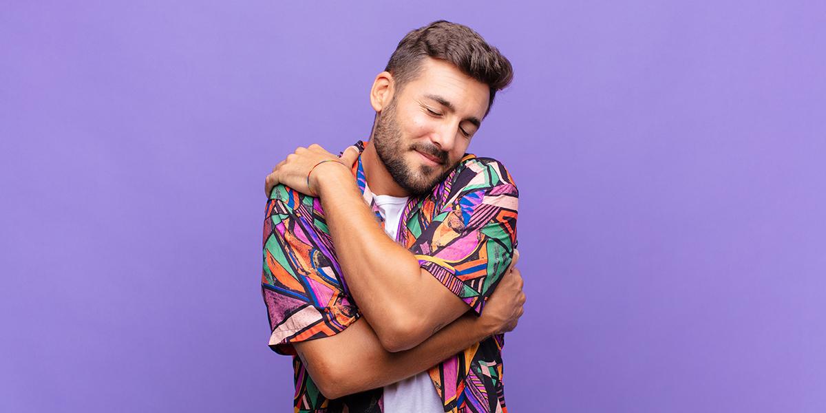 love yourself - man hugging himself