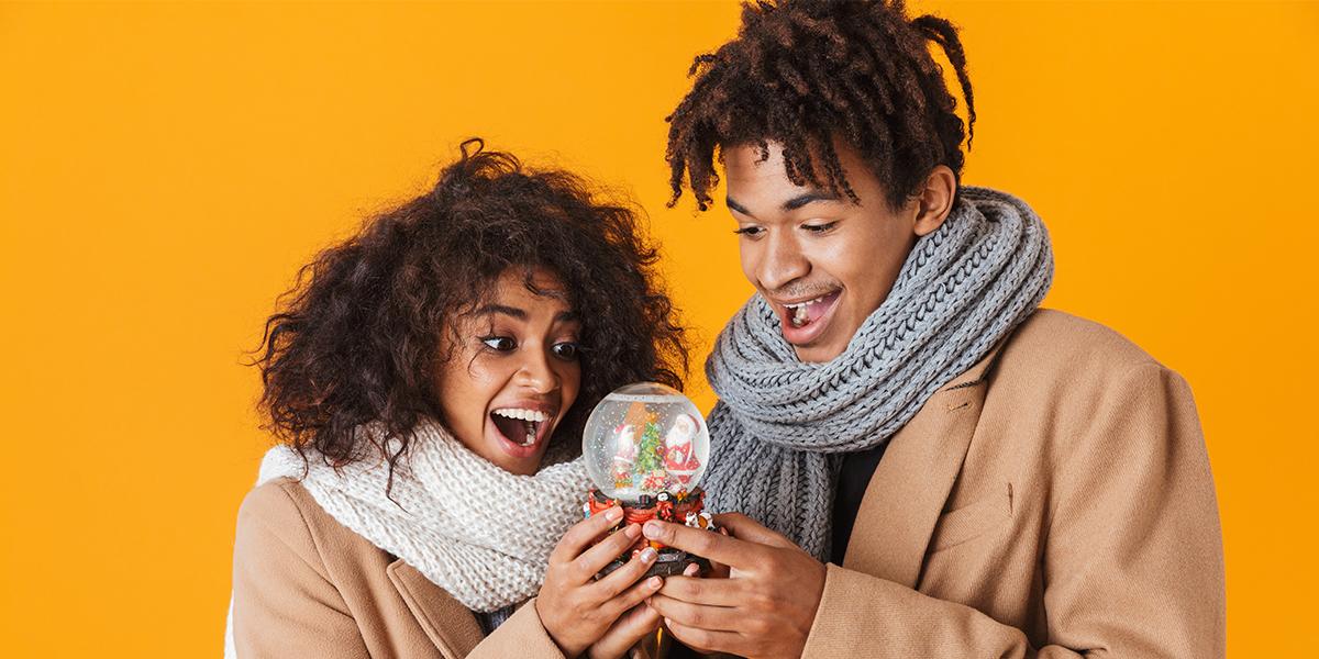 happy couple with snow globe