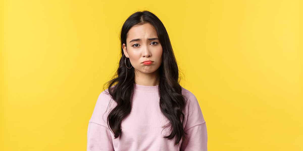 Sad girl on a yellow background