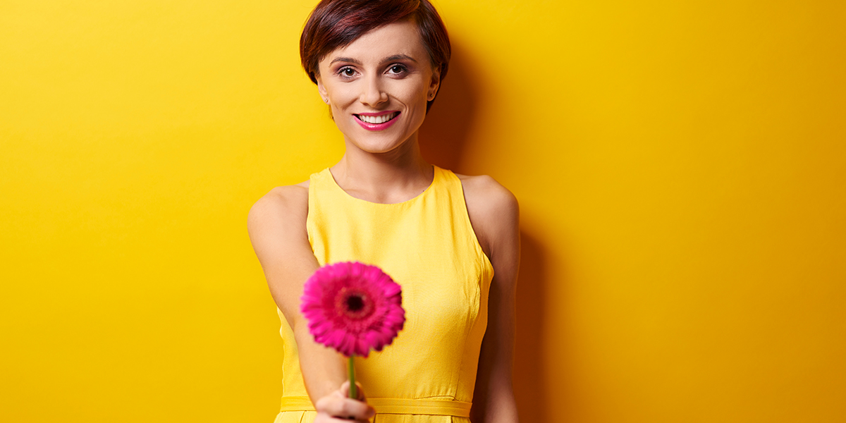 Woman giving flower.