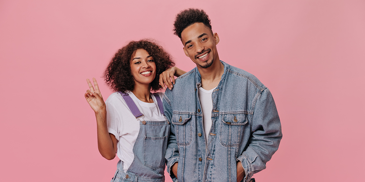 types of relationships - young couple on a pink background