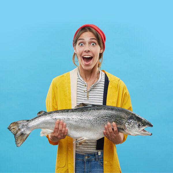Fish puns - Woman holding fish