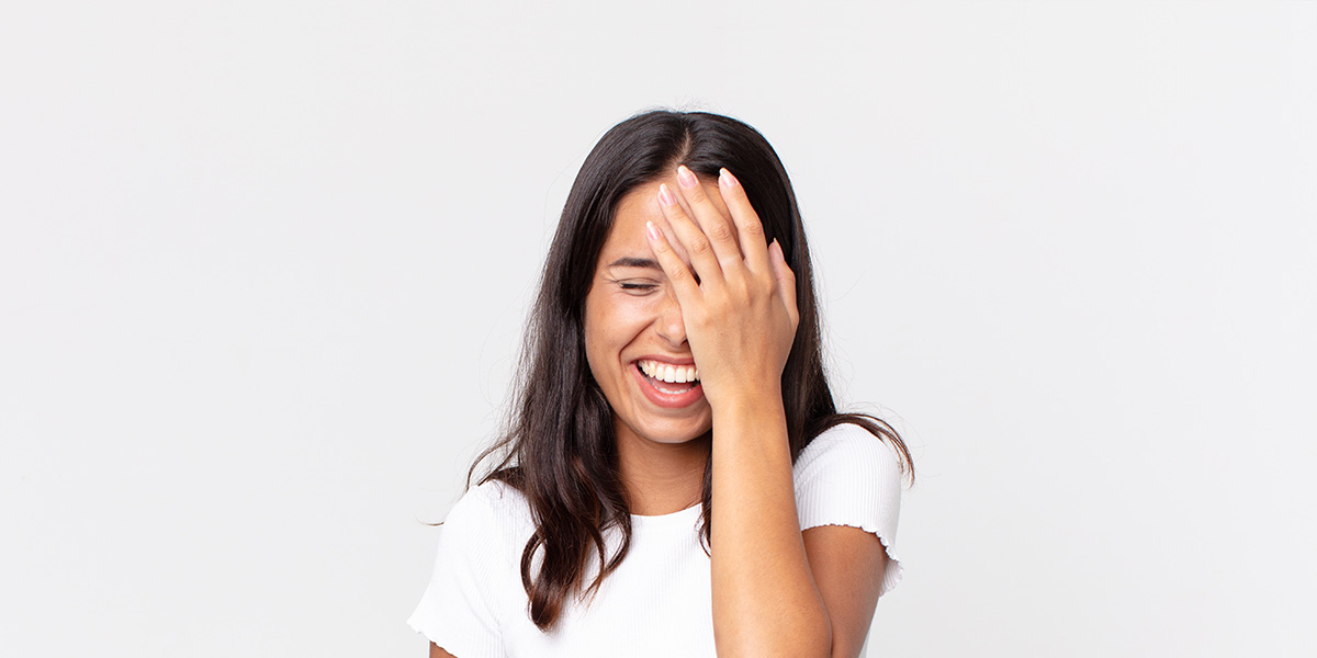 A woman laughing.